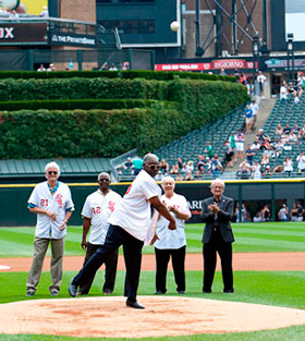 Ex-teammates Rich (Goose) Gossage, Bill Melton, Bart Johnson, Hank Allen, Ed Spiezio and Roland Hemond look on while Allen prepares to throw the ceremonial first pitch.