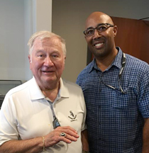 Harold Baines (right), MLB's No. 1 draft choice in 1977 who is now a White Sox ambassador, lets longtime Sox season ticket-holder Archie Fletcher try on his 2005 World Series ring.
