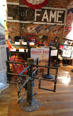 Bruce Hellerstein loves old Crosley Field, so he displays a turnstile and other artifacts from the small Cincinnati ballpark.