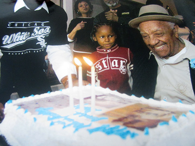 Duty was all smiles for his 100th birthday cake in 2002.