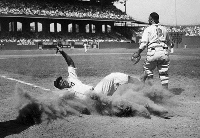 Clouds of dust at home plate, such as in this East-West All-Star Game at Comiskey Park, were part of the taste of Negro League life for Duty.