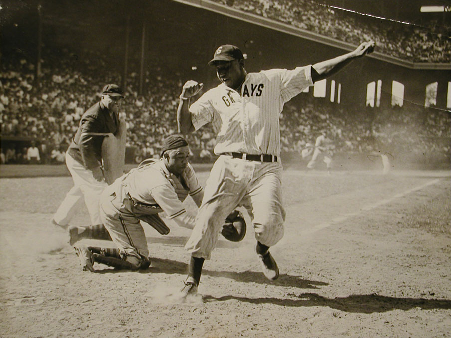 Star catcher Double Duty Radcliffe tags fellow Negro League luminary Josh Gibson during the East-West All-Star Game at old Comiskey Park.