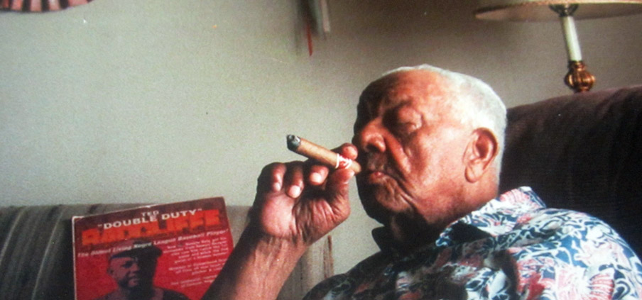 The consummate pose of Duty — enjoying life with his ever-present cigar.