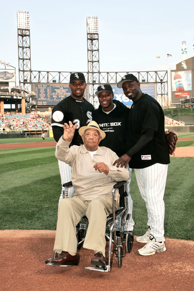 "While throwing out the first pitch at U.S. Cellular Field, ""Duty"" could regale (from left behind him) Harold Baines, Willie Harris and Carl Everett stories of not only the Negro Leagues, but playing and managing on an integrated team in North Dakota in 1934. Photo courtesy of Chicago White Sox."