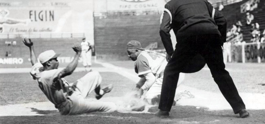 Duty tagging a baserunner out at home. He had permanently gnarled fingers from his catching days.