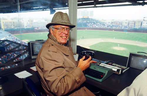 Jack Rosenberg with a typical pose in the old WGN-TV broadcast booth, ready to work with his trusty manual typewriter.