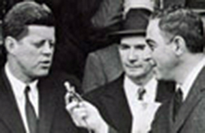 John F. Kennedy barely tolerates the Leadoff Man interview conducted by Vince Lloyd (right) at Griffith Stadium in 1961. Jack Rosenberg pulled some strings to even get a couple of minutes with JFK.