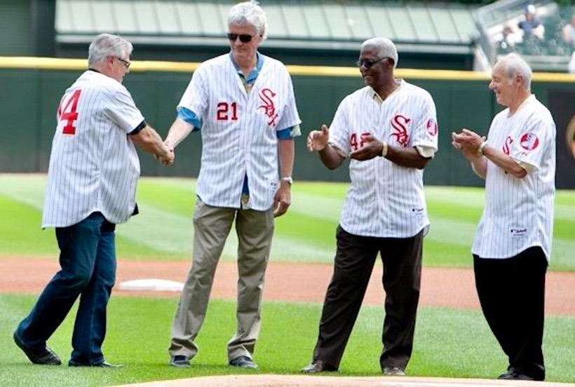 Bart Johnson (No. 21) shakes Bill Melton's hand at the 1972 Sox's 40th anniversary reunion in 2012. Injuries to Johnson and home-run champion Melton likely cost the Sox the American League West title amid a close race with the Oakland Athletics.