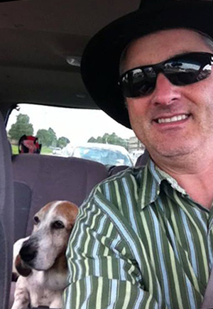 Kyle McNary, shown here with his late basset hound Lula, became Duty's official biographer and thus was recipient of a lifetime of stories.