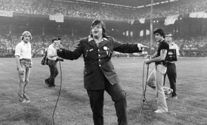 Steve Dahl in all his glory revving up the crowd on Disco Demolition Night. Photo by Paul Natkin.
